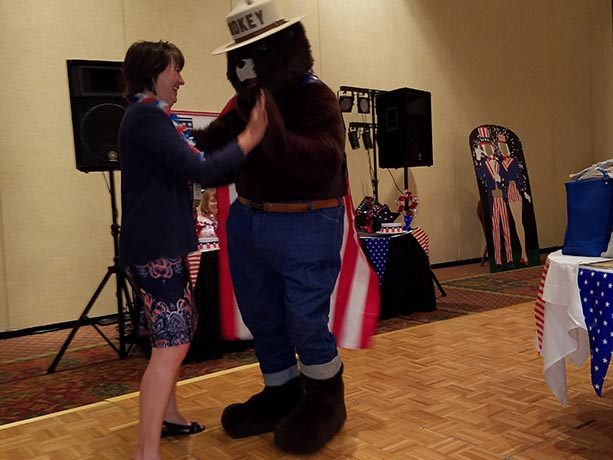 State Forester and Smokey Enjoy a Dance
